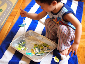 Boy playing with DIY Fishing Game