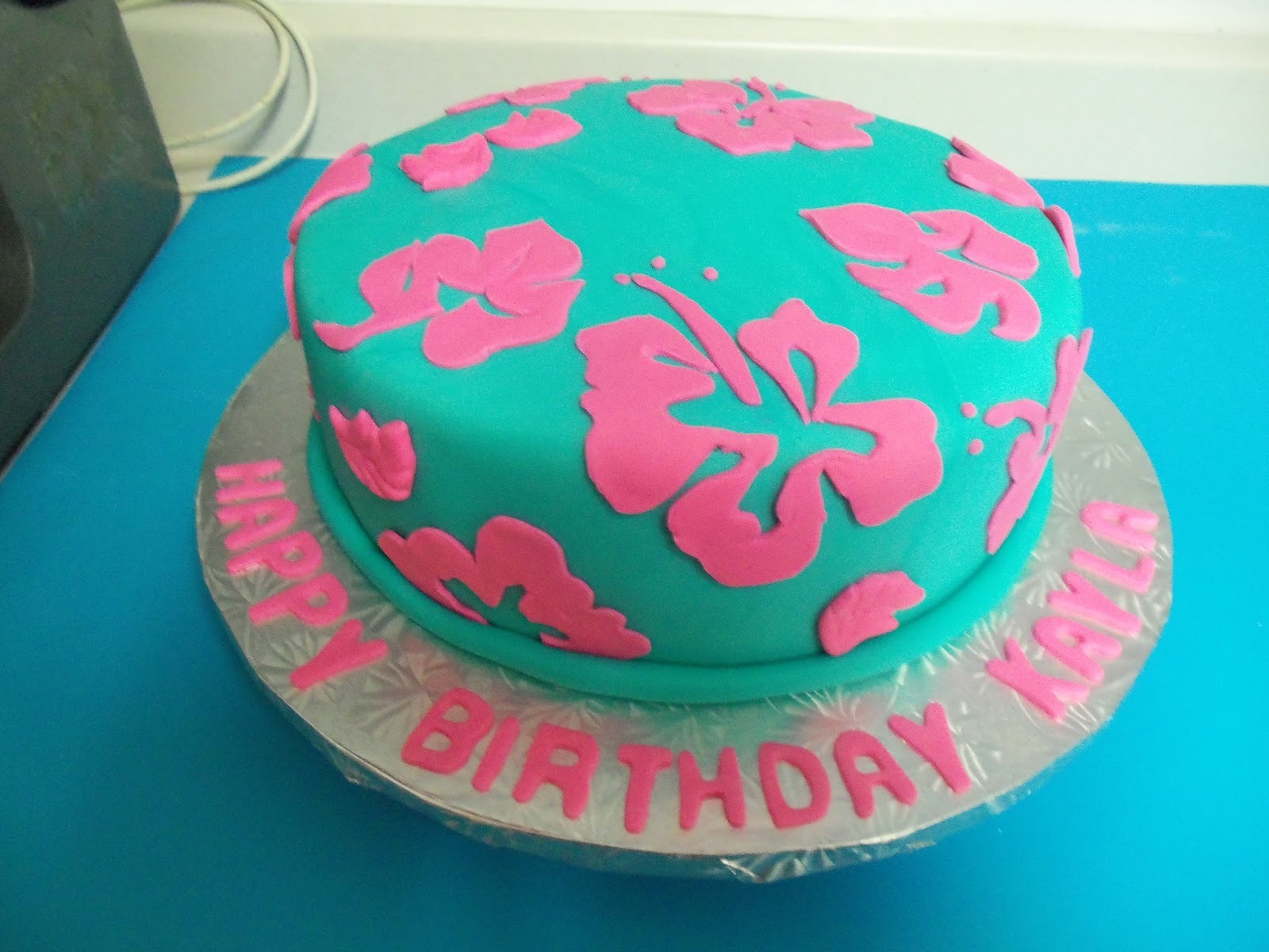 Sugarbakers cake design tropical delight birthday cake marble birthday cake with chocolate icing and fondant i hand cut each flower design from fondant with use of a paper template i then attached them to the izmirmasajfo