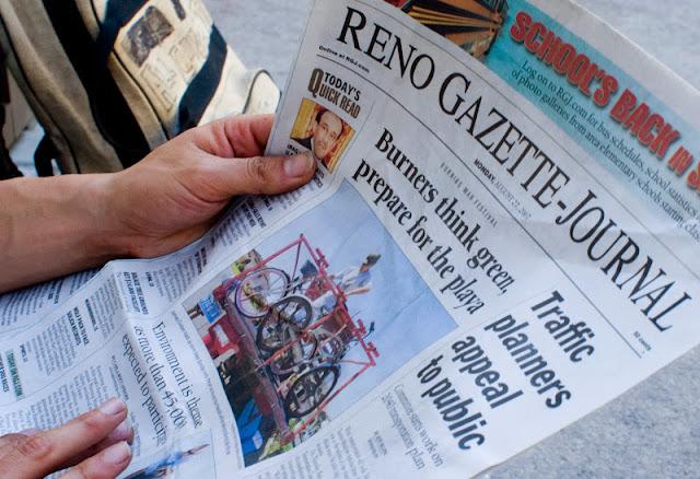 reno newspaper with burning man headline