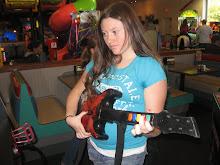 Naomi as a guitarist