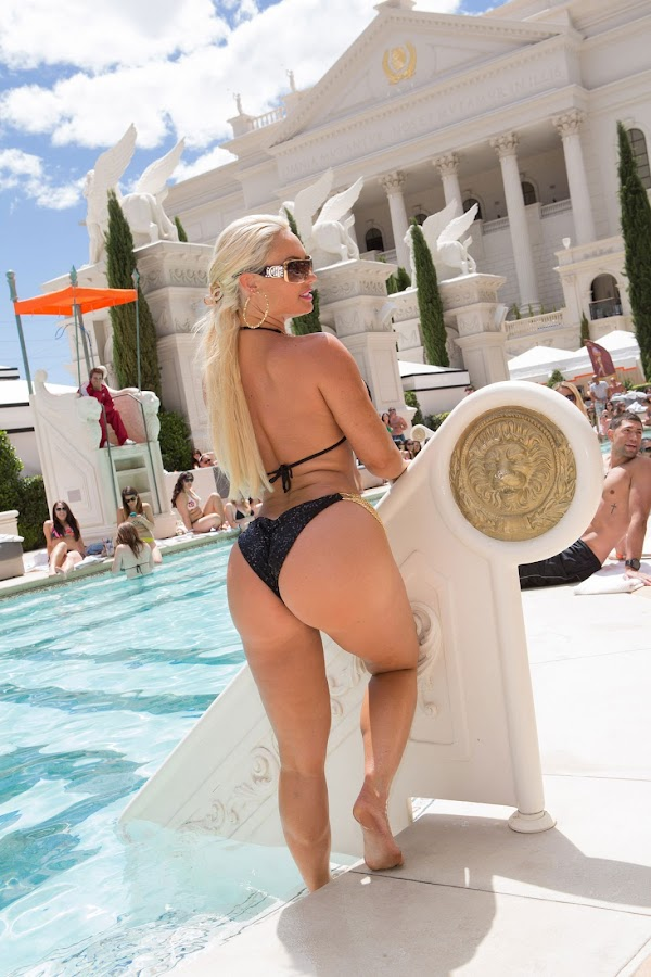Nicole Coco Austin posing by the pool