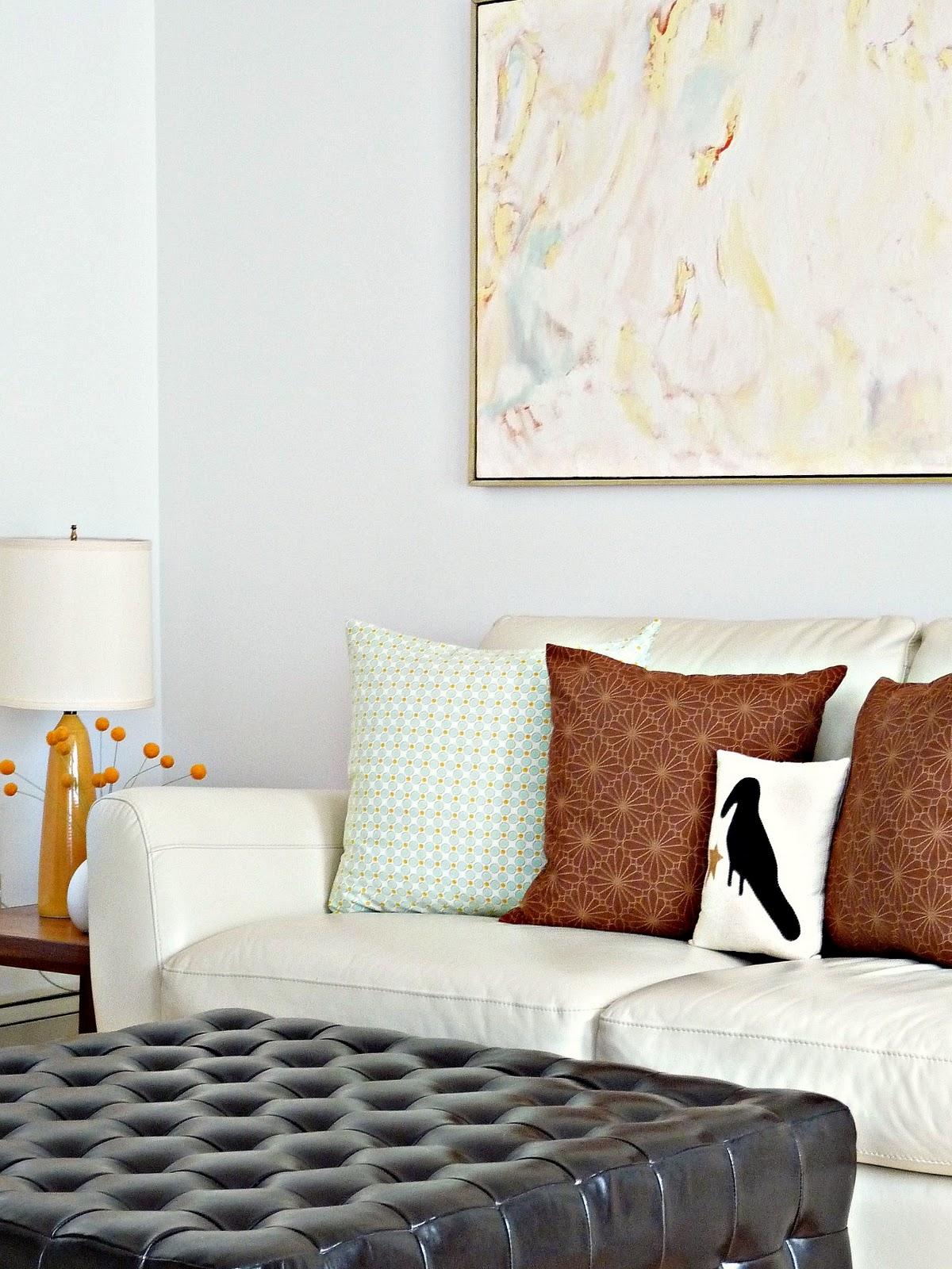 Cream leather sofa; Danish teak side tables