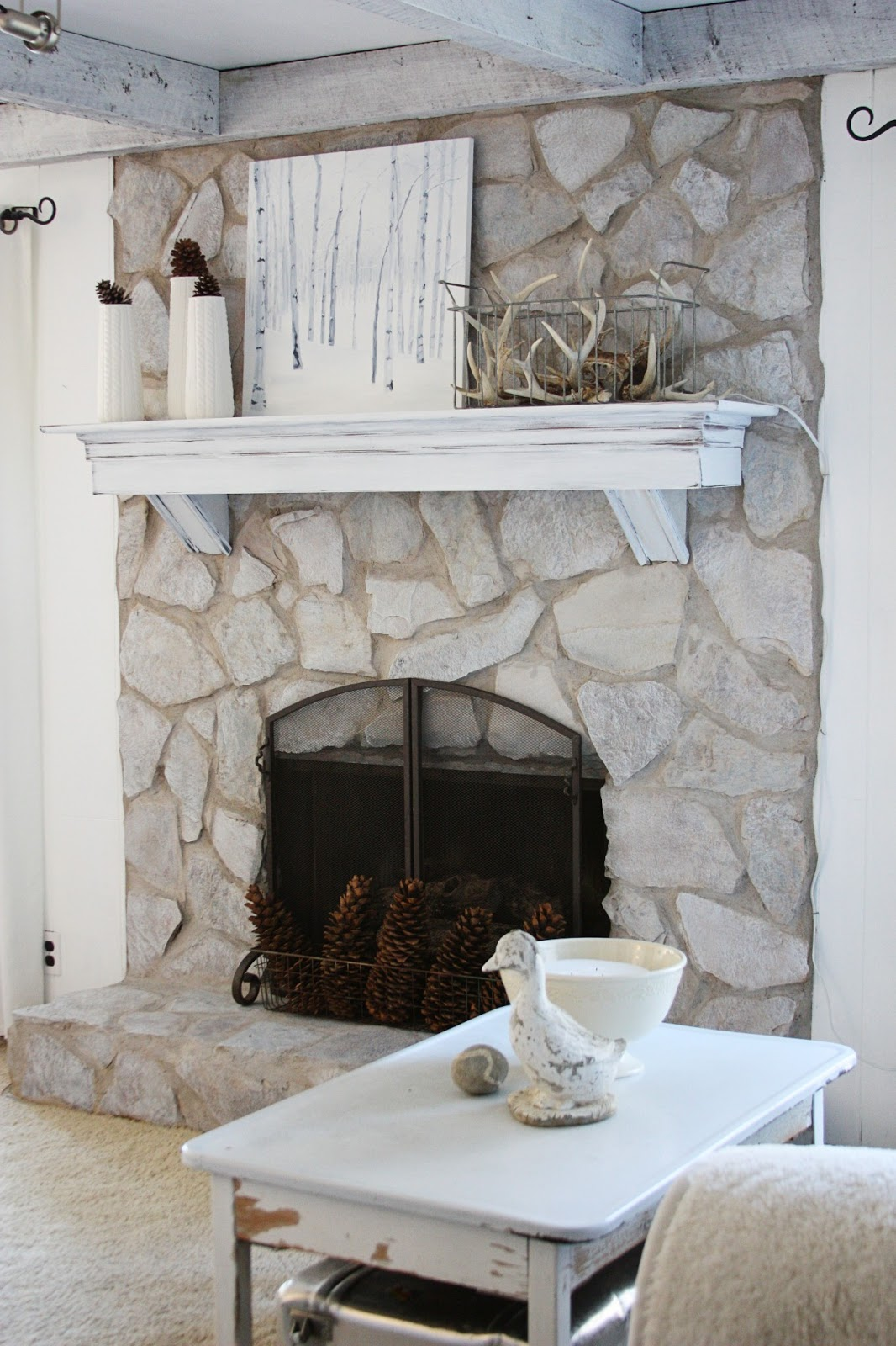 old stone fireplace. so much better  erin s art and gardens painted stone fireplace before after