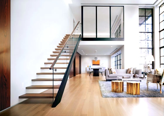 Modern New York City Apartment glass staircase railing light wood floor shag rug tree stump side table