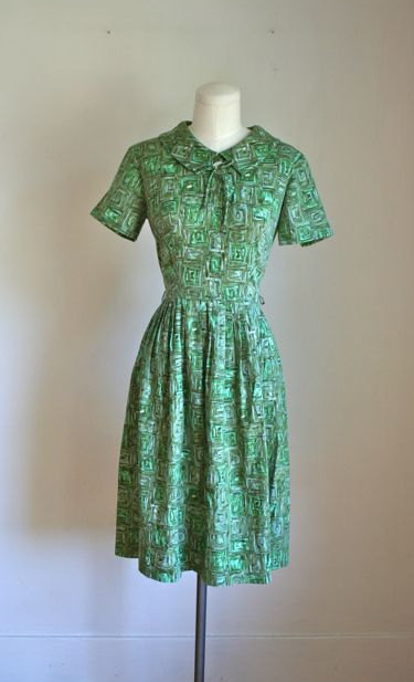 vintage 60s abstract print green dress with short sleeves and peter pan collar with bow