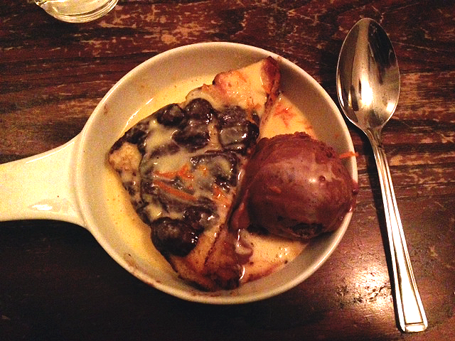a pudding of chocolate brioche with ice cream and custard