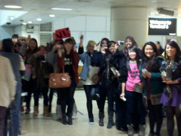 Fans of Big Bang at Heathrow Airport