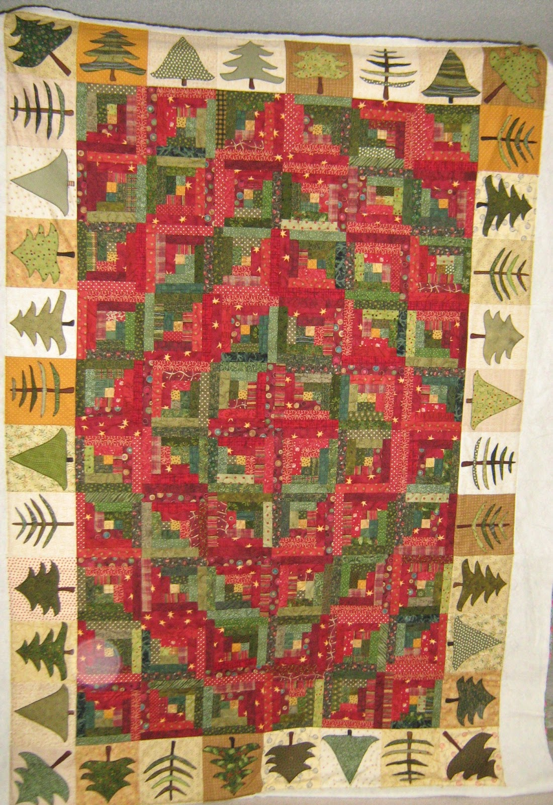 Inch by quilting christmas log cabin quilt