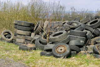 Tires dumping an a neighborhood.