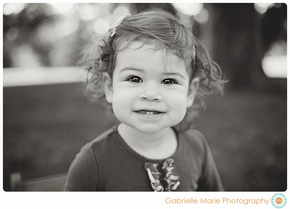 18 month old girl with curly hair and big bright eyes, black and white photo
