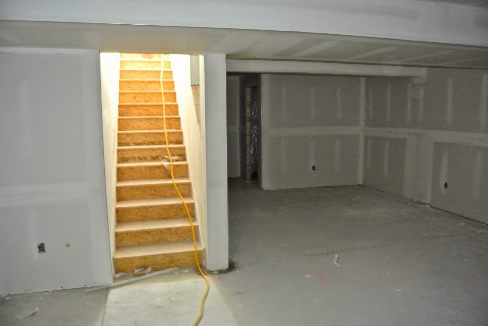 Picture of the finished basement with drywall installed