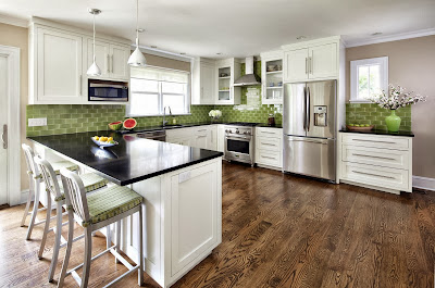 modern wide kitchen in white and black with reflective black counter top and green tiles