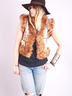 Vintage 1970's bohemian style shearling embroidered fur vest.