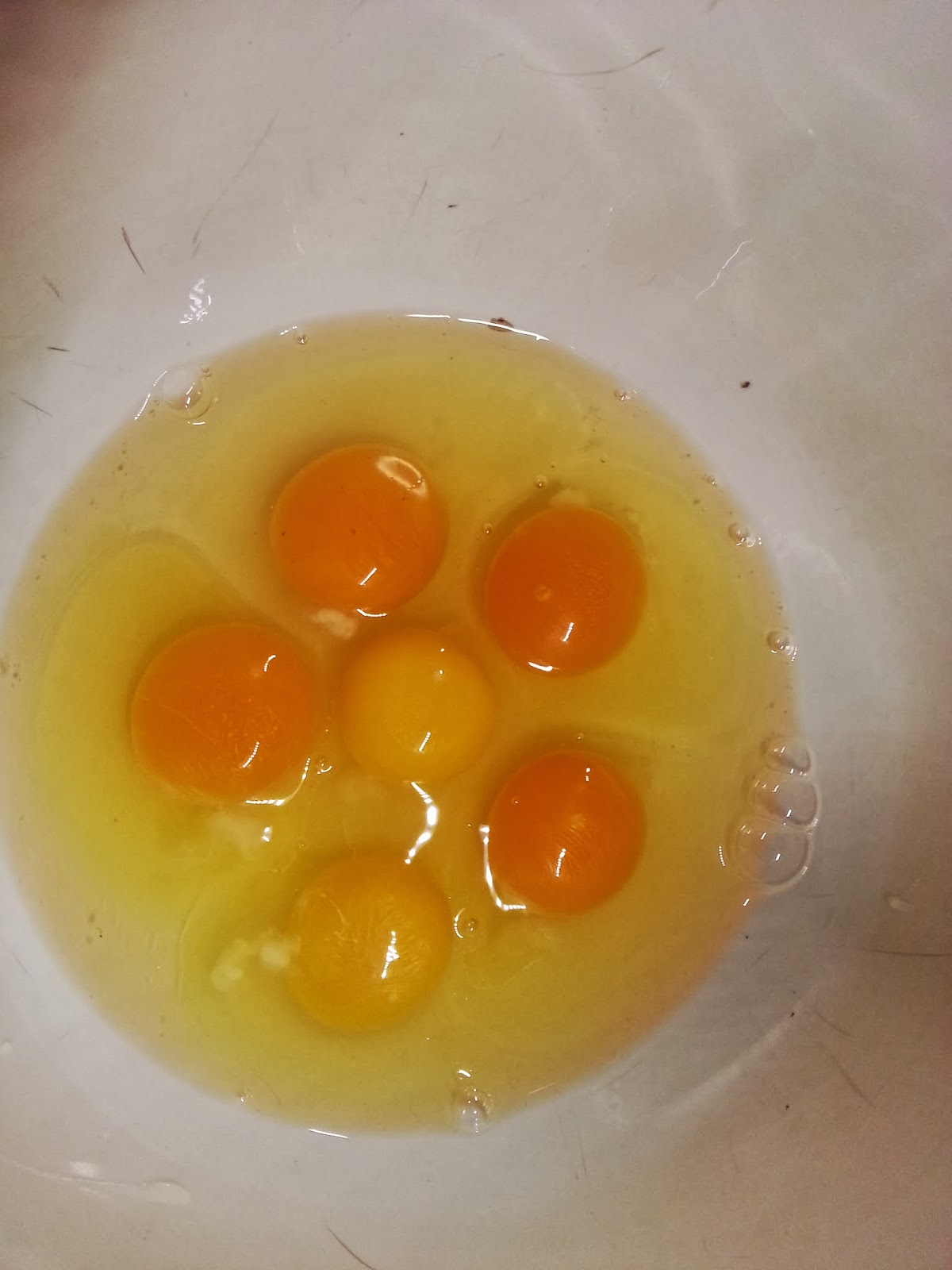 Comparing eggs from store and our chickens