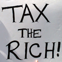 sign saying, tax the rich!