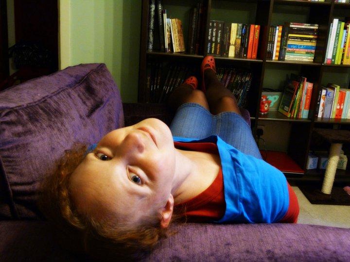Sarah Rooftops on purple armchair