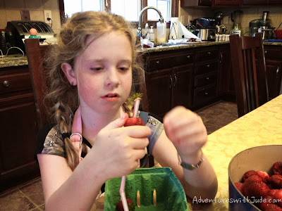 remove strawberry hulls with a drinking straw