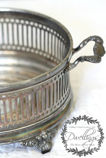 Silver serving dish turned candle holder.