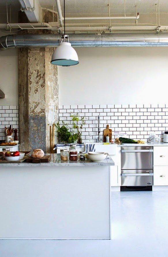 This Rustic Industrial Kitchen Features A Raw Concrete Beam Running Through The Middle Flanked By White Cabinets Subway Tiles With Black Grout