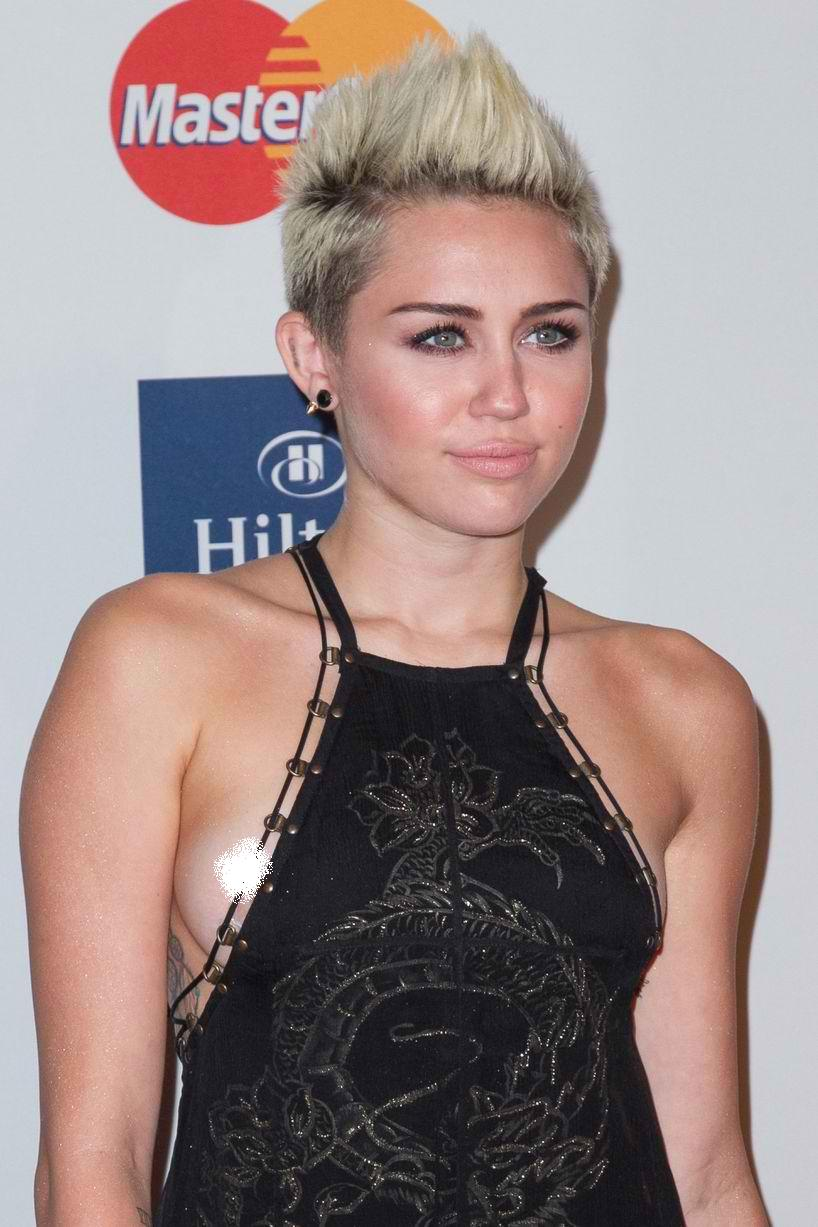 Miley Cyrus Uncensored Wardrobe Malfunction, Nip Slip at Pre Grammy ...