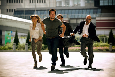 Mark Wahlberg and Stanley Tucci in Transformers Age of Extinction