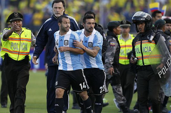 Javier Mascherano is restrained by Argentina teammate Ezequiel Lavezzi after his sending off