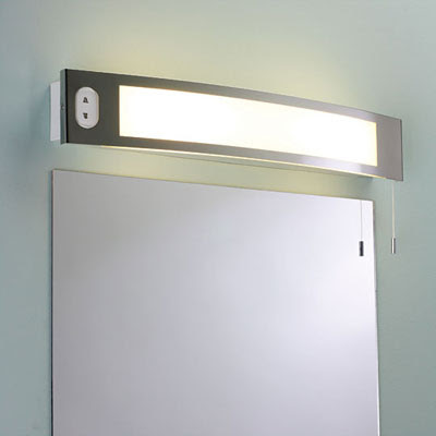 The Astro Seville Shaver Wall Light, above the mirror bathroom light