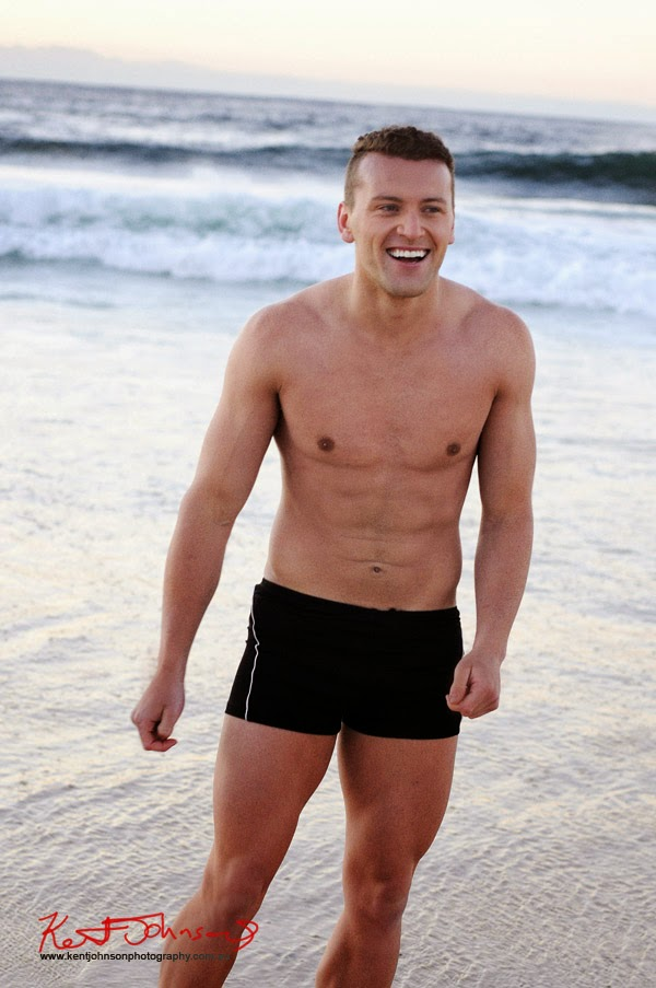 Laughing on the beach, dawn shoot at Bondi Beach men's model portfolio by Kent Johnson.