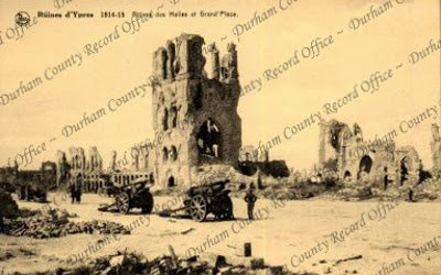 Postcard of a view of the ruined Cloth Hall and Market Place, taken at Ypres, Belgium, 1914 - 1918 (D/DLI 2/35/9(1))