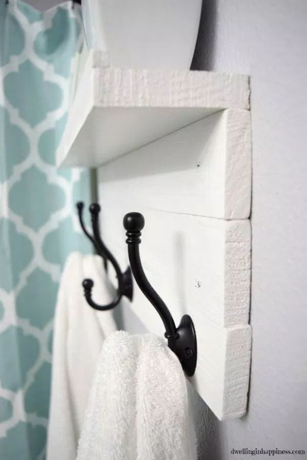 http://www.dwellinginhappiness.com/diy-towel-rack-with-a-shelf/