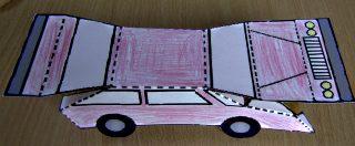 Afbeelding van auto van papier tijdens plooien