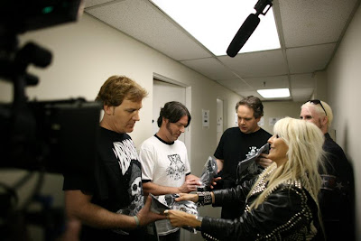 Eddie Trunk, Don Jamieson and Jim Florentine getting gifts from Doro Pesch