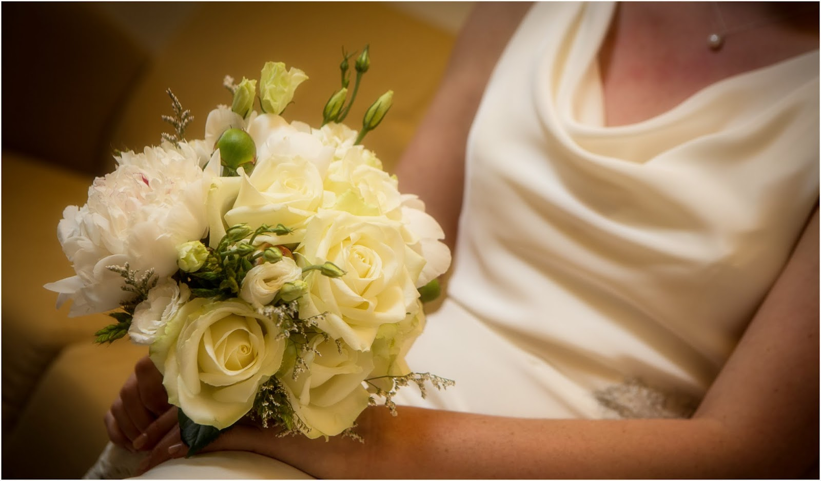 white romatic bridal bouquet with roses, lisianthus and peonies