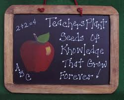 mini chalkboard that says teachers plant seeds of knowledge that grow forever