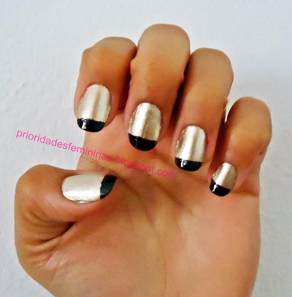 nail art dorada com preto