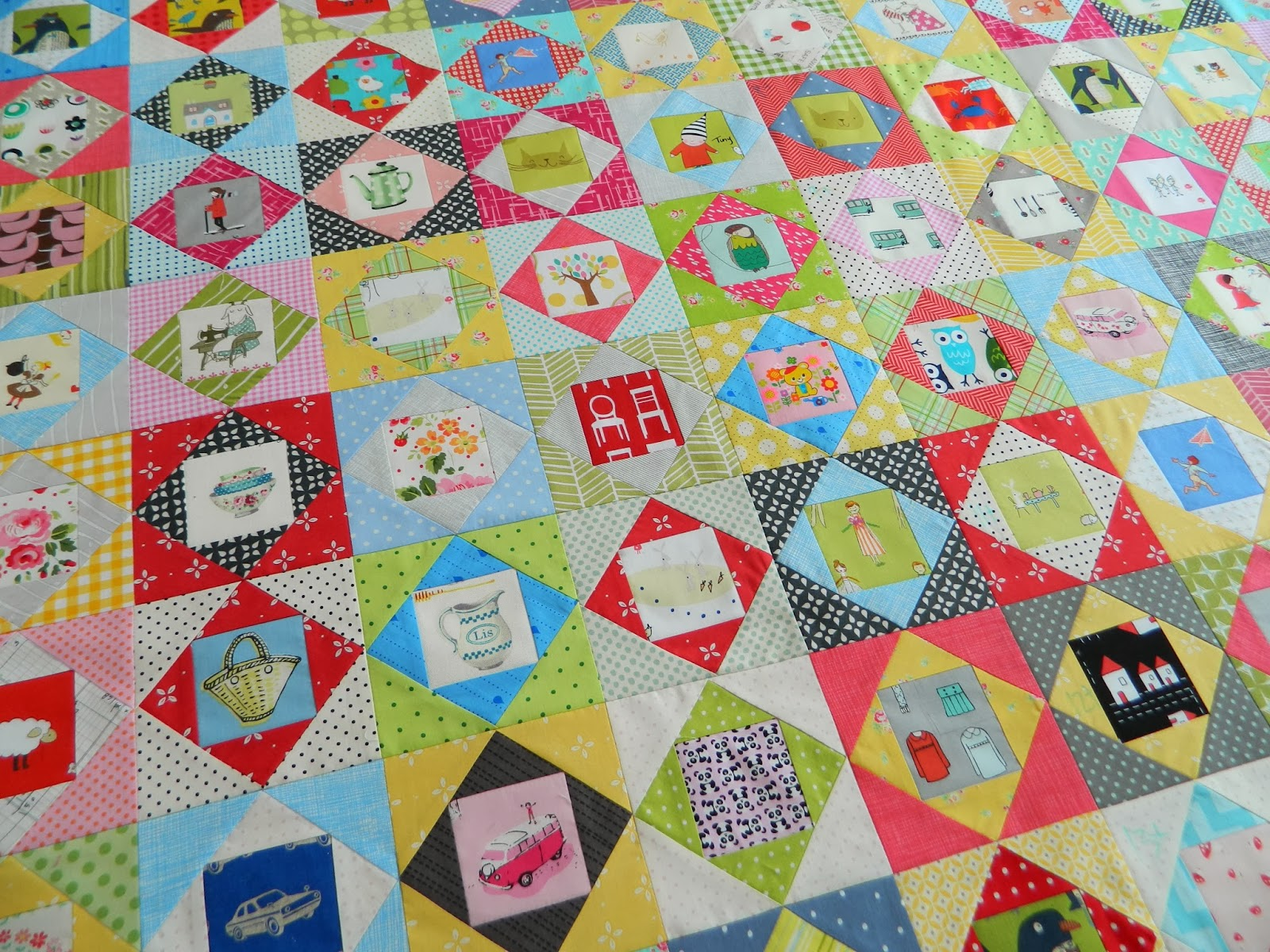 http://sotakhandmade.blogspot.com/2014/01/economy-block-quilt-all-finished.html