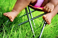 Baby in lawn chair. Stock Photo credit: Shune