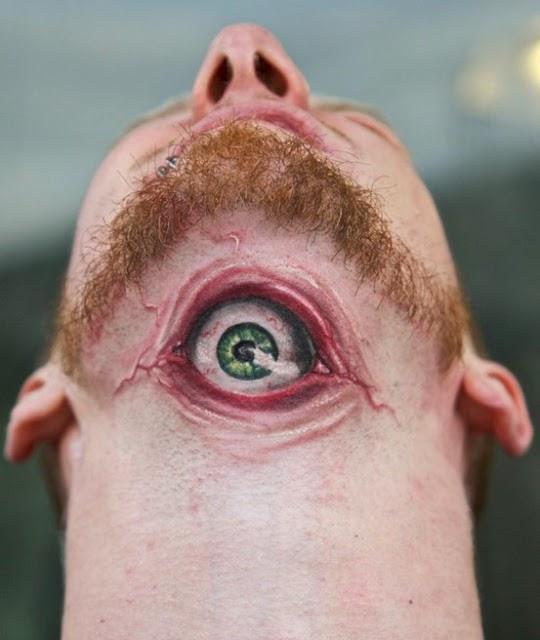 3D eye tattoo on throat
