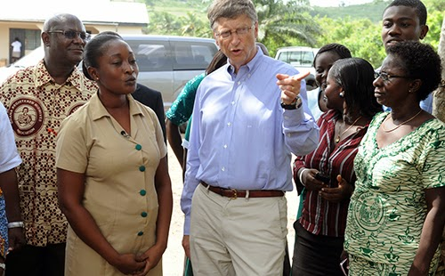 Bill Gates talking to poor African