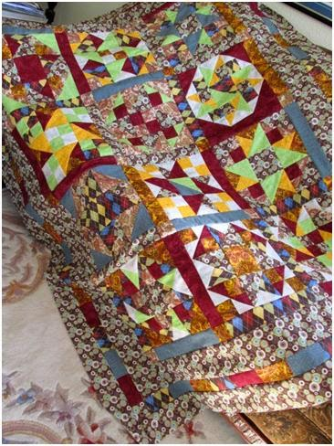 One quilt pattern made twelve different ways by The Quilt Ladies
