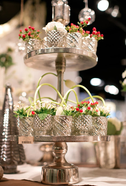 Display table with mercury glass and Christmas florals in Accent Decor