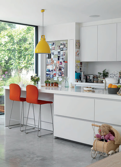 Irenie Cossey's bulthaup kitchen with Jasper Morisson chairs and a vintage lamp, photographed by Tim Young