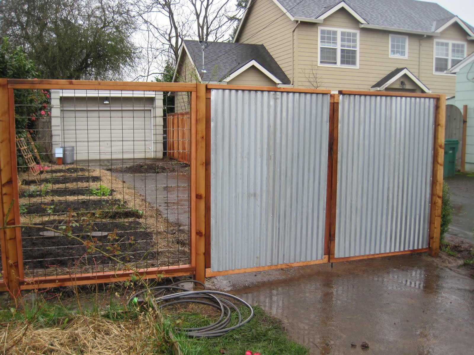 Steel Fence Construction : Aristata land arts building fences in the rain
