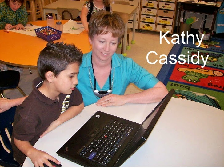 This is a picture of Kathy Cassidy working with on of her students on a laptop computer.