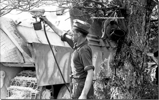 A German soldier gives a Jagdpanther a fresh coat of paint