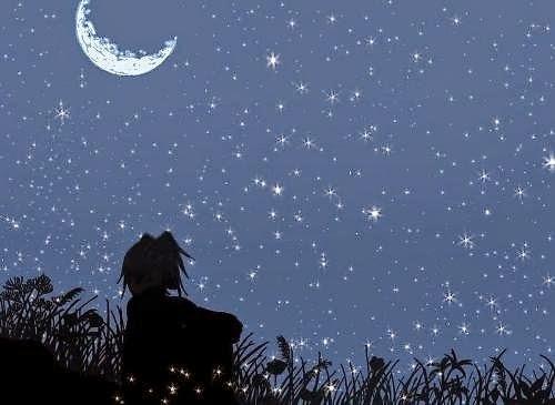 Hình ảnh chàng trai buồn ngồi nhìn lên trời đầy sao