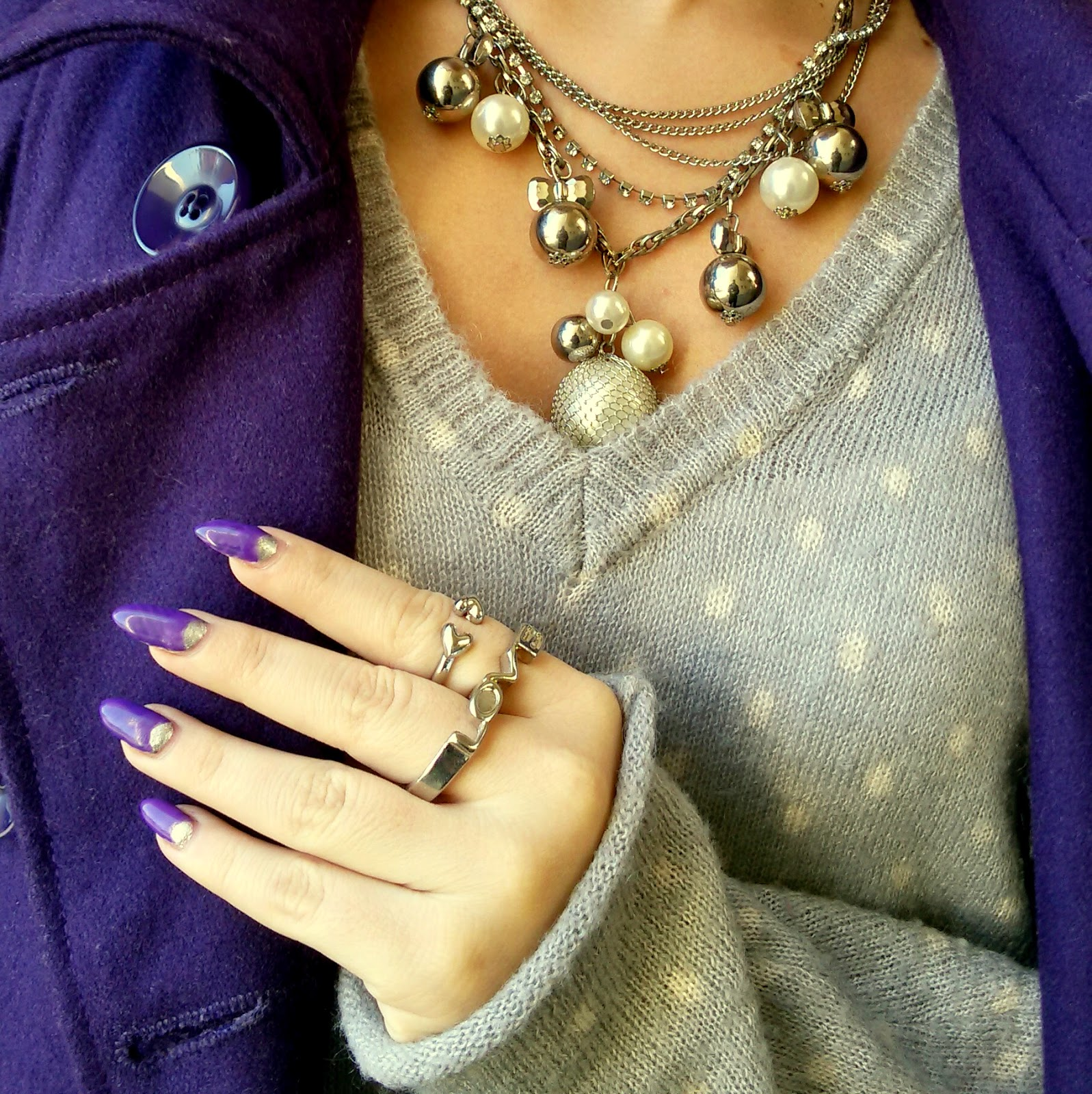 outfit, stiletto nails, purple stiletto mails, half moon stiletto nails, purple coat, grey polka dots sweater, black flared high waisted shorts, over the knee boots,