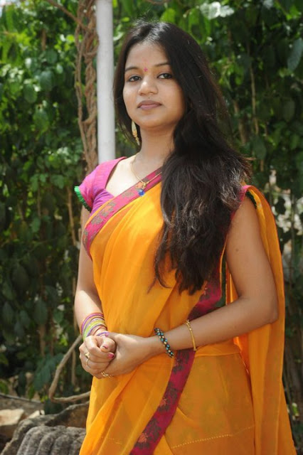 Kerala long hair women in traditional saree