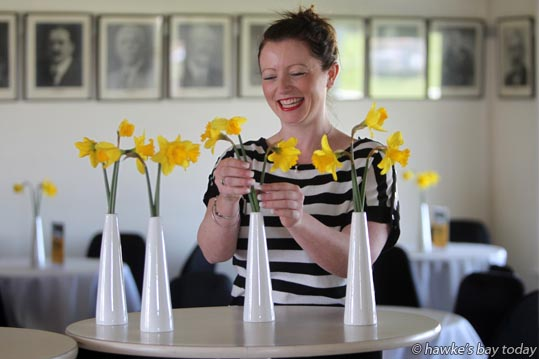 Alana Waters, administration manager at Hawke's Bay Racing, arranging flowers in The Committee Lounge at the Hawke's Bay Racing Centre, Hastings Racecourse, Hastings, in preparation for tomorrow's Makfi Challenge Stakes Daffodil Raceday. photograph
