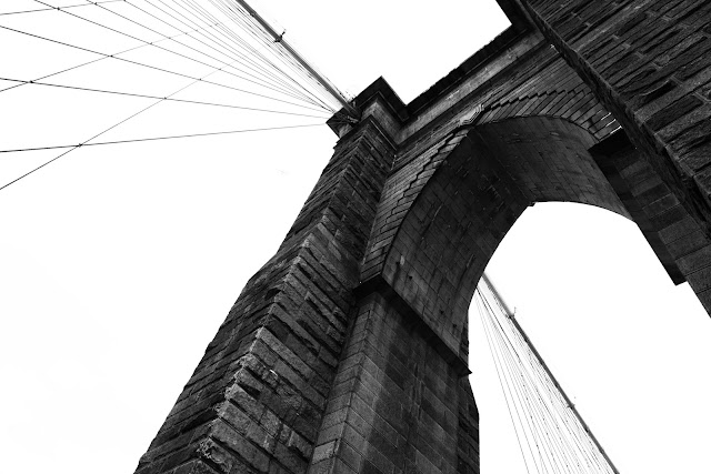 Standing on and looking up at the Brooklyn Bridge on the way back to Manhattan.